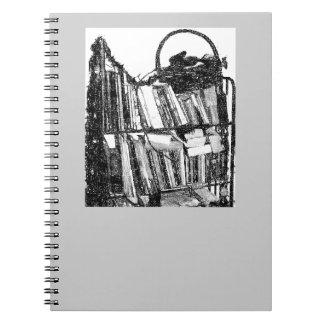 Esboço do lápis da estante do material caderno espiral