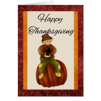 Espantalho no cartão feliz da acção de graças da