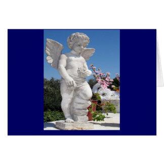 Estátua do anjo no azul cartão comemorativo