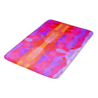 Esteira do roxo, a cor-de-rosa e a alaranjada do tapete de banheiro