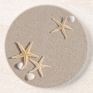 Estrela do mar nas portas copos da praia porta copos de arenito