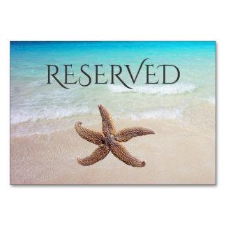 Estrela do mar no cartão reservado do assento da