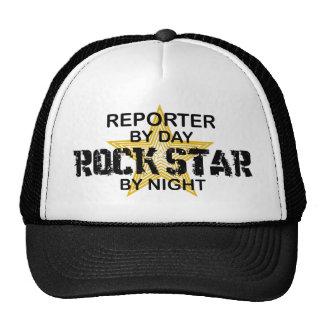 Estrela do rock do repórter em a noite boné