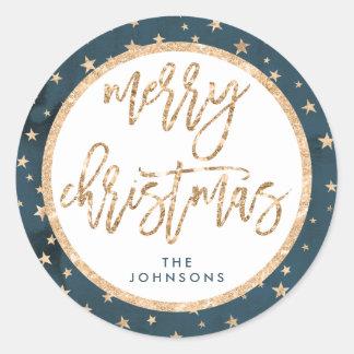 Estrela redonda do ouro da etiqueta do Feliz Natal