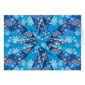 Estrelas azuis com os flocos de neve no cartão de