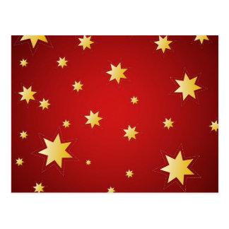 Estrelas sparkling do Natal no vermelho Cartão Postal