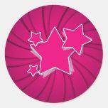 Estrelas super do rosa quente e fundo do adesivos redondos