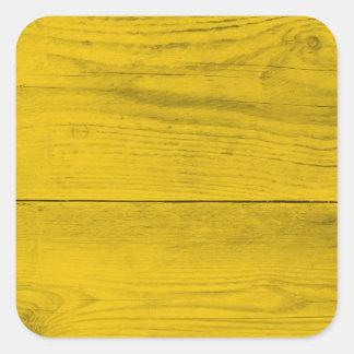 Estrutura de madeira amarela como uma textura do adesivo quadrado