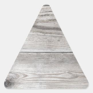 Estrutura de madeira não tratada como a textura do adesivo triangular