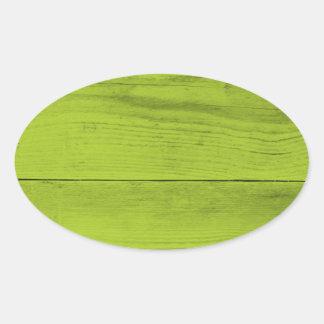 Estrutura de madeira verde-clara como um textur do adesivo oval