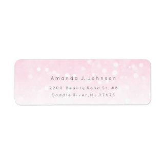 Etiqueta Bokhe ilumina o endereço cor-de-rosa delicado de