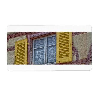 Etiqueta casas Alsatian da fachada de cores diferentes