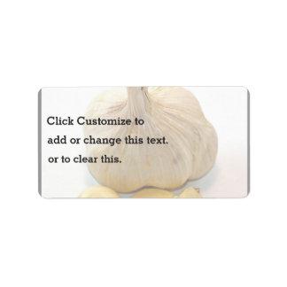 Etiqueta Cinco fatias do alho e um cravo-da-índia de alho