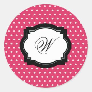 Etiqueta cor-de-rosa da inicial das bolinhas