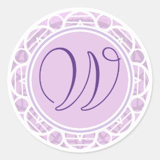Etiqueta cor-de-rosa laçado do monograma da flor