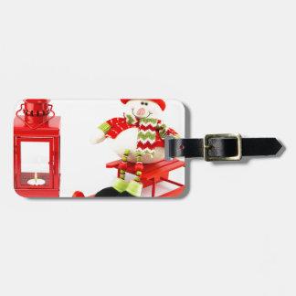 Etiqueta De Bagagem Boneco de neve no trenó com lanterna vermelha