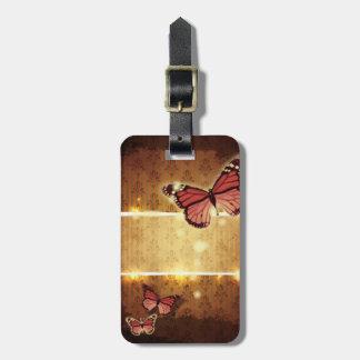 Etiqueta De Bagagem borboleta alaranjada dos redemoinhos do flourish