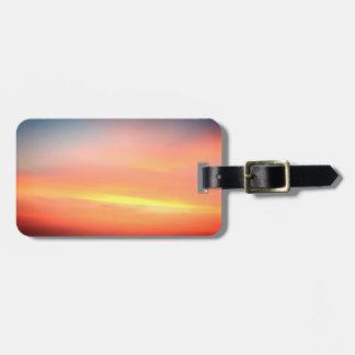 Etiqueta De Bagagem Do Tag alaranjado da bagagem do céu do por do sol