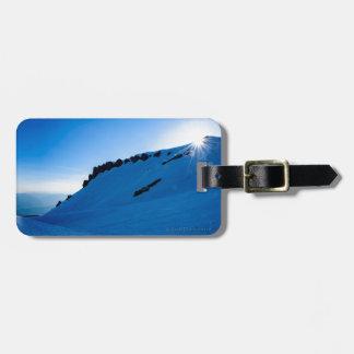 Etiqueta De Bagagem Por do sol em uma montanha nevado