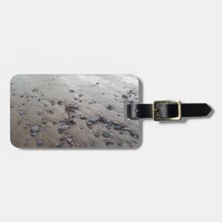 Etiqueta De Bagagem Seixos no Tag da bagagem da areia