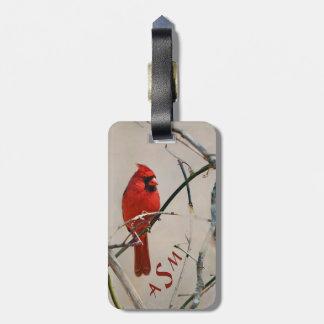 Etiqueta De Bagagem Um pássaro cardinal vermelho em um ramo nas
