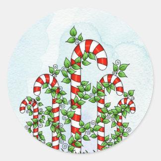 Etiqueta do Natal dos bastões e das videiras de