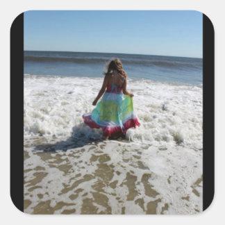 Etiqueta do vestido do oceano da areia da praia da