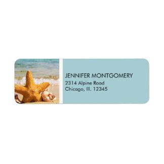 Etiqueta Estrela do mar e Seashells na praia