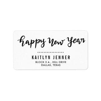 Etiqueta Feriado escrito à mão do feliz ano novo ocasional
