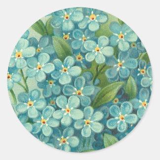 Etiqueta floral do vintage com miosótis azuis adesivo