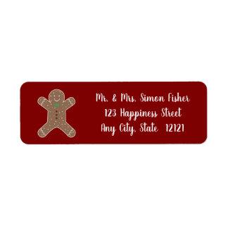 Etiqueta Homem de pão-de-espécie do Natal no vermelho