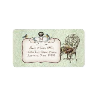 Etiqueta O ninho dos pássaros do vintage na cadeira,