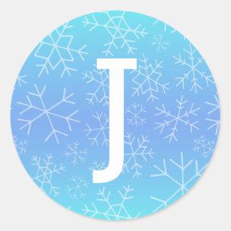 Etiqueta tirada do monograma do floco de neve de