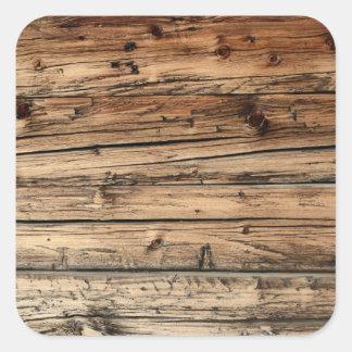 Etiqueta velha do fundo da textura da madeira de adesivo quadrado