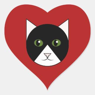 Etiqueta vermelha do coração com a cara do gato do