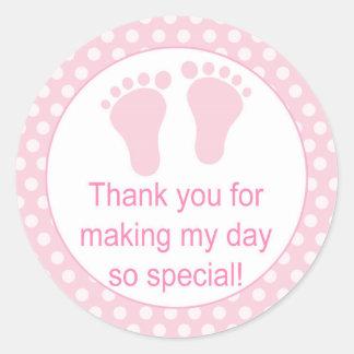 Etiquetas cor-de-rosa das bolinhas dos pés do bebê