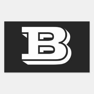 Etiquetas do preto da pia batismal da letra B