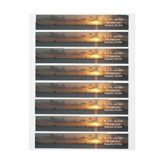 Etiquetas Por do sol com a foto tropical da paisagem dos