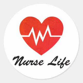 Etiquetas vermelhas do coração da vida EKG da