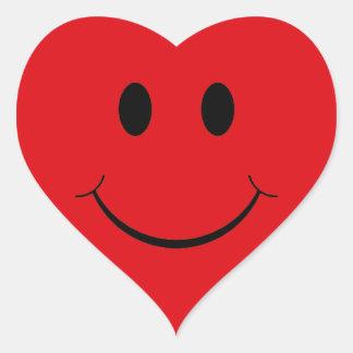 Etiquetas vermelhas do smiley face do coração adesivo
