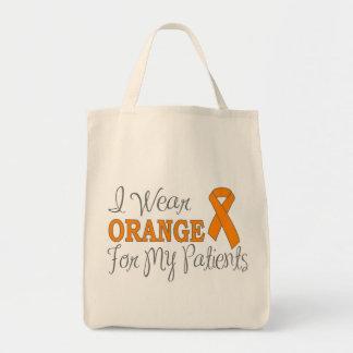 Eu visto a laranja para meus pacientes (a fita ala bolsa para compras