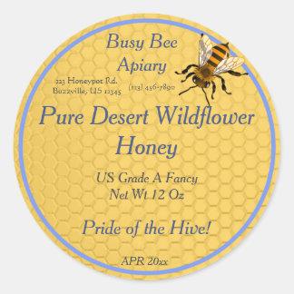 Favo de mel redondo com única etiqueta do mel da adesivo