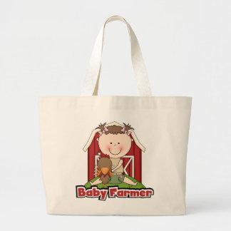 Fazendeiro de bebê com camiseta e presentes do gal bolsa