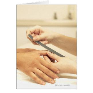 Feche acima do manicure cartao