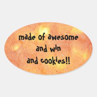 feito de impressionantes e vitória e biscoitos - adesivo oval