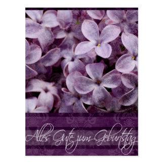 Feliz aniversario nas flores alemãs do Lilac Cartoes Postais