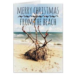 Feliz Natal do cartão da praia