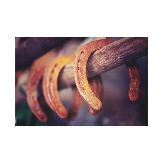 Ferraduras no país de madeira do vaqueiro do impressão em tela