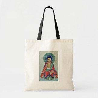 Figura religiosa que senta-se em uns lótus com hal bolsa de lona