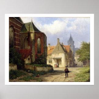 Figure antes de uma igreja Redbrick em uma cidade  Poster